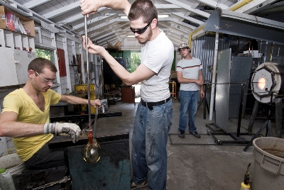 """Ryan, Tim and Phillip (L to R) working in their """"hive."""""""